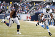 Reggie Bush #21 of the Detroit Lions runs past Jon Bostic #57 of the Chicago Bears for a touchdown during the first quarter at Soldier Field on December 21, 2014 in Chicago, Illinois.