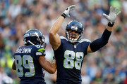 Doug Baldwin #89 of the Seattle Seahawks celebrates with Jimmy Graham #88 of the Seattle Seahawks after scoring a touchdown during the second quarter of a game against the Detroit Lions at CenturyLink Field on October 5, 2015 in Seattle, Washington.