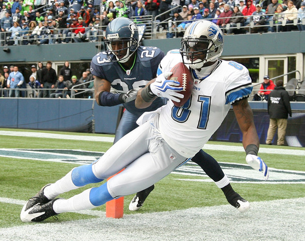 Calvin Johnson Wide receiver Calvin Johnson #81 of the Detroit Lions makes a catch at the one-yard line against Marcus Trufant #23 of the Seattle Seahawks on November 8, 2009 at Qwest Field in Seattle, Washington. Johnson was ruled out of bounds on the play and  the Seahawks defeated the Lions 32-20.