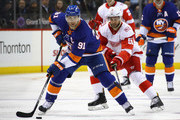 John Tavares #91 of the New York Islanders carries the puck ahead of Frans Nielsen #51 of the Detroit Red Wings during the first period at the Barclays Center on December 19, 2017 in the Brooklyn borough of New York City.