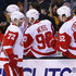 Erik Cole Photos - Erik Cole #72 of the Detroit Red Wings is congratulated by teammates after scoring a goal against the Boston Bruins during the second period at TD Garden on March 8, 2015 in Boston, Massachusetts. - Detroit Red Wings v Boston Bruins
