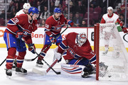 Goaltender Antti Niemi #37 of the Montreal Canadiens reaches in the net for the puck after allowing a goal against the Detroit Red Wings during the NHL game at the Bell Centre on October 15, 2018 in Montreal, Quebec, Canada.  The Montreal Canadiens defeated the Detroit Red Wings 7-3.