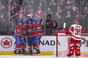 Tomas Plekanec #14 of the Montreal Canadiens celebrates his first period goal in his 1000th career NHL game with teammates against the Detroit Red Wings at the Bell Centre on October 15, 2018 in Montreal, Quebec, Canada.