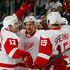 Pavel Datsyuk Niklas Kronwall Photos - (l-r) Pavel Datsyuk #13, Niklas Kronwall #55 and Riley Sheahan #15 of the Detroit Red Wings celebrate a powerplay goal by Sheehan at 3:52 of the first period against the New Jersey Devils at the Prudential Center on November 28, 2014 in Newark, New Jersey. - Detroit Red Wings v New Jersey Devils