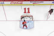 Chris Neil #25 gathers pucks while wearing a vintage jersey in honour of Daniel Alfredsson's jersey retirement during warm-ups prior to a game against the Detroit Red Wings at Canadian Tire Centre on December 29, 2016 in Ottawa, Ontario, Canada.  (Photo by Jana Chytilova/Freestyle Photography/Getty Images) *** Local Caption ***