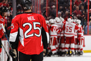 Chris Neil #25 of the Ottawa Senators looks on as the Detroit Red Wings celebrate their overtime win at Canadian Tire Centre on December 29, 2016 in Ottawa, Ontario, Canada.