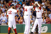Daniel Nava #29 is congratulated by teammates David Ortiz #34 and Mike Napoli #12 of the Boston Red Sox after hitting a two-run home run in the 6th inning against the Detroit Tigers during the game on September 4, 2013 at Fenway Park in Boston, Massachusetts.
