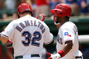 Josh Hamilton #32 of the Texas Rangers is congratulated by teammate Elvis Andrus #1 after hitting a two run homer against Rick Porcello of the Detroit Tigers in the first inning on August 12, 2012 at the Rangers Ballpark in Arlington in Arlington, Texas.