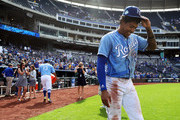 Adalberto Mondesi #27 of the Kansas City Royals smiles after being doused with water by catcher Salvador Perez #13 after the Royals defeated Detroit Tigers 9-2 to win the game against the Detroit Tigers at Kauffman Stadium on August 29, 2018 in Kansas City, Missouri.
