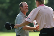 Jerry Kelly shakes hands with Steve Stricker on the 18th green during the third round of the Deutsche Bank Championship held at TPC Boston on September 6, 2009 in Norton, Massachusetts.