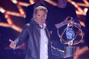 """Juror Dieter Bohlen shows the trophy during the season 16 finals of the tv competition show """"Deutschland sucht den Superstar"""" (DSDS) at Coloneum on April 27, 2019 in Cologne, Germany."""