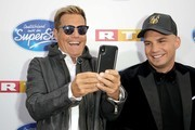 """Jurors Dieter Bohlen and Pietro Lombardi take a selfie as they attend the season 16 finals of the tv competition show """"Deutschland sucht den Superstar"""" (DSDS) at Coloneum on April 27, 2019 in Cologne, Germany."""