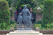 Members of the public view the statue of Diana, Princess of Wales, in the Sunken Garden at Kensington Palace on July 02, 2021 in London, England. July 1st would have been the 60th birthday of Princess Diana, who died in 1997. At a ceremony here yesterday, her sons Prince Harry, Duke of Sussex and Prince William, Duke of Cambridge, unveiled the statue, by sculptor Ian Rank-Broadley, in her memory.  Photo by Jonathan Brady-WPA Pool/Getty Images)