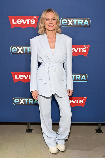 Diane Kruger Visits 'Extra' [diane kruger,extra,suit,clothing,pantsuit,formal wear,blazer,outerwear,fashion,footwear,carpet,electric blue,the levis store times square,new york city]