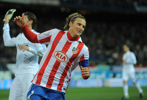 Diego Forlan Diego Forlan of Atletico Madrid reacts during the Copa del Rey quarter final second leg match between Atletico Madrid and Real Madrid at Vicente Calderon Stadium on January 20, 2011 in Madrid, Spain.