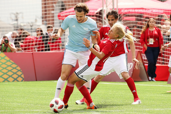 Legends Football Match - 2018 FIFA World Cup Russia [sports,team sport,ball game,player,soccer,sport venue,soccer player,football player,tournament,sports equipment,diego forlan,c,marina fedorova,action,rest,soccer,russia,park,red square,legends football match - 2018 fifa world cup]
