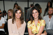(L to R) Carine Roitfeld and Julia Restoin-Roitfeld attend the Diesel Black Gold Spring 2012 fashion show during Mercedes-Benz Fashion Week at Pier 94 on September 13, 2011 in New York City.
