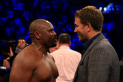 Dereck Chisora speaks to Eddie Hearn in the ring after the Heavyweight fight between Dereck Chisora and Carlos Takam at The O2 Arena on July 28, 2018 in London, England.