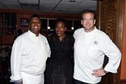 (L-R) Chefs Carlos Brown, Tren'ness Woods-Black and Michael White attend the Harlem EatUp! Festival at Sylvia's Restaurant on May 15, 2015 in New York City.