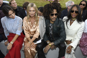 (L-R) Victoria Beckham, Kate Moss, Lenny Kravitz and Naomi Campbell attend the Dior Homme Menswear Spring/Summer 2019 show as part of Paris Fashion Week on June 23, 2018 in Paris, France.