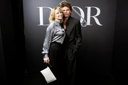 Courtney Love and Jordan Barrett attend the Dior Homme Menswear Fall/Winter 2020-2021 show as part of Paris Fashion Week on January 17, 2020 in Paris, France.