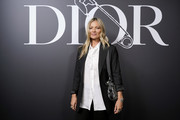 Kate Moss attends the Dior Homme Menswear Fall/Winter 2020-2021 show as part of Paris Fashion Week on January 17, 2020 in Paris, France.