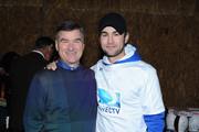 DIRECTV Chairman, President & CEO Michael White (L) and Chace Crawford attend the DirecTV Beach Bowl at Pier 40 on February 1, 2014 in New York City.