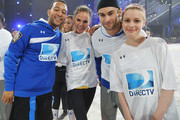 John Legend, Chrissy Teigen, Chace Crawford and Gillian Jacobs participate in the DirecTV Beach Bowl at Pier 40 on February 1, 2014 in New York City.