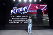 "Trey Wingo speaks onstage as ESPN+ Presents: a Fireside Chat with NFL Legend Jim Brown and Trey Wingo, during an exclusive screening of original series ""Peyton's Places"", at the Disney+ Showcase at Disney's D23 EXPO 2019 in Anaheim, CA. ""Peyton's Places"" will stream exclusively on Disney+, which launches November 12."