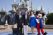 """In this handout photo provided by Disney parks, DAZZLING DAY - Academy Award-winning composer Richard Sherman and actress and singer  Ashley Brown join President of the Disneyland Resort Michael Colglazier (L) and Mickey Mouse to celebrate the 60th anniversary of Disneyland park July 17, 2015 in Anaheim, California.  Celebrating six decades of magic, the Disneyland Resort Diamond Celebration features three new nighttime spectaculars that immerse guests in the worlds of Disney stories like never before with """"Paint the Night,"""" the first all-LED parade at the resort; """"Disneyland Forever,"""" a reinvention of classic fireworks that adds projections to pyrotechnics to transform the park experience; and a moving new version of """"World of Color"""" that celebrates Walt Disney's dream for Disneyland."""