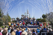 """In this handout photo provided by Disney parks, Mickey Mouse and his friends celebrate the 60th anniversary of Disneyland park during a ceremony at Sleeping Beauty Castle featuring Academy Award-winning composer, Richard Sherman and Broadway actress and singer Ashley Brown July 17, 2015 in Anaheim, California.  Celebrating six decades of magic, the Disneyland Resort Diamond Celebration features three new nighttime spectaculars that immerse guests in the worlds of Disney stories like never before with """"Paint the Night,"""" the first all-LED parade at the resort; """"Disneyland Forever,"""" a reinvention of classic fireworks that adds projections to pyrotechnics to transform the park experience; and a moving new version of """"World of Color"""" that celebrates Walt Disneys dream for Disneyland."""