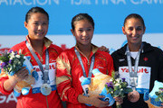 (L-R) Silver medal winner Han Wang of China, Gold medal winner Zi He of China and Bronze medal winner Pamela Ware of Canada celebrate after the Women's 3m Springboard Diving Semifinal round on day eight of the 15th FINA World Championships at Piscina Municipal de Montjuic on July 27, 2013 in Barcelona, Spain.