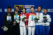 Gold medallists Han Wang and Hao Yang of China pose with silver medallists Jennifer Abel and Francois Imbeau-Dulac of Canada and bronze medallists Tania Cagnotto and Maicol Verzotto of Italy during the medal ceremony for the 3m Springboard Synchronised Mixed Diving Final on day nine of the 16th FINA World Championships at the Aquatics Palace on August 2, 2015 in Kazan, Russia.