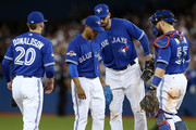 Marcus Stroman #6 of the Toronto Blue Jays is congratulated by teammates as he leaves the game in the eighth inning against the Texas Rangers during game two of the American League Division Series at Rogers Centre on October 9, 2015 in Toronto, Canada.