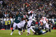 Cornerback Robert Alford #23 of the Atlanta Falcons throws a pass against defensive tackle Fletcher Cox #91 of the Philadelphia Eagles during the second quarter in the NFC Divisional Playoff game at Lincoln Financial Field on January 13, 2018 in Philadelphia, Pennsylvania.