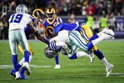 Running back Ezekiel Elliott #21 of the Dallas Cowboys is stopped by inside linebacker Cory Littleton #58 of the Los Angeles Rams after a 3-yard gain in the NFC Divisional Round playoff game at Los Angeles Memorial Coliseum on January 12, 2019 in Los Angeles, California.