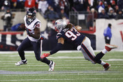 Lamar Miller #26 of the Houston Texans evades a tackle by Jabaal Sheard #93 of the New England Patriots in the first half during the AFC Divisional Playoff Game at Gillette Stadium on January 14, 2017 in Foxboro, Massachusetts.