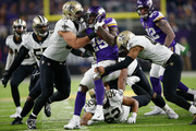 Latavius Murray #25 of the Minnesota Vikings is tackled by Manti Te'o #51 of the New Orleans Saints during the second half of the NFC Divisional Playoff game at U.S. Bank Stadium on January 14, 2018 in Minneapolis, Minnesota.