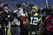 Quarterback Aaron Rodgers #12 of the Green Bay Packers celebrates after their 28-23 win over the Seattle Seahawks in the NFC Divisional Playoff game at Lambeau Field on January 12, 2020 in Green Bay, Wisconsin.