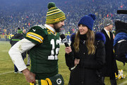 Aaron Rodgers #12 of the Green Bay Packers is interviewed by Erin Andrews after defeating the Seattle Seahawks 28-23 in the NFC Divisional Playoff game at Lambeau Field on January 12, 2020 in Green Bay, Wisconsin.