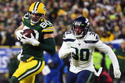 Jimmy Graham #80 of the Green Bay Packers makes a reception against Bradley McDougald #30 of the Seattle Seahawks during the first half in the NFC Divisional Playoff game at Lambeau Field on January 12, 2020 in Green Bay, Wisconsin.