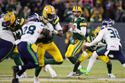 Aaron Rodgers #12 of the Green Bay Packers looks to pass during the second half against the Seattle Seahawks in the NFC Divisional Playoff game at Lambeau Field on January 12, 2020 in Green Bay, Wisconsin.