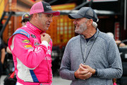 Elliott Sadler, driver of the #1 OneMain Financial Chevrolet, speaks with NASCAR Hall of Famer Dale Jarrett in the garage area during practice for the NASCAR Xfinity Series Bar Harbor 200 presented by Sea Watch International at Dover International Speedway on October 5, 2018 in Dover, Delaware.
