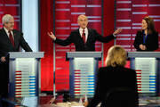 U.S. Rep. Ron Paul (R-TX) (C) speaks whaile former speaker of the House Newt Gingrich (L) and U.S. Rep. Michele Bachmann (R-MN) look on during the ABC News GOP Presidential debate on the campus of Drake University on December 10, 2011 in Des Moines, Iowa. Rivals were expected to target front runner Gingrich in the debate hosted by ABC News, Yahoo News, WOI-TV, The Des Moines Register and the Iowa GOP.