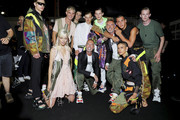 Dan Caten and Dean Caten pose backstage with models ahead of the Dsquared2 show during Milan Men's Fashion Week Spring/Summer 2019 on June 17, 2018 in Milan, Italy.