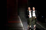 Fashion designers Dean and Dan Caten acknowledges the audience on the runway at the Dsquared2 show during Milan Men's Fashion Week Spring/Summer 2019 on June 17, 2018 in Milan, Italy.