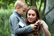 Catherine, Duchess of Cambridge speaks with Josh Evans at photography workshop for Action for Children, run by the Royal Photographic Society at Warren Park on June 25, 2019 in Kingston, England.