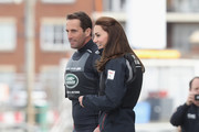 Catherine, Duchess of Cambridge, patron of the 1851 Trust,  boards a Land Rover BAR Racing catamaran with Sir Ben Ainslie at Land Rover BAR on May 20, 2016 in Portsmouth, England. The Duchess of Cambridge is launching the 1851 Trust's two sailing projects and meeting people involved in the project. Afterwards she will open the 'Tech Deck' Education Centre at the heart of the base.