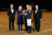 Camilla, Duchess of Cornwall presents the Raymond Brooks-Ward Memorial Trophy to winner Jessica Mendoza during The London International Horse Show at Olympia Exhibition Centre on December 17, 2015 in London, England.
