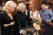 Camilla, The Duchess of Cornwall (2L) pulls a pint of beer as she meets actors Beverley Callard, who plays landlady Liz McDonald (L), Anne Kirkbride, who plays the role of Deirdre Barlow (2nd R) and Ryan Thomas, who plays the role of Jason Grimshaw (R) during a tour to the Rovers Return Pub on the set of British television soap opera 'Coronation Street' on February 4, 2010 in Manchester, England.